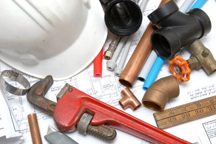 Plumbing parts, tools, and plans used by Drain King Plumbing And Drain Services LLC.